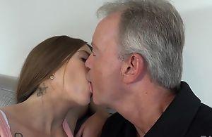 Sex-starved brunette pleasuring old bloke on the sofa
