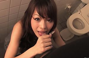 Easygoing Asian MILF gives head in focus on toilet