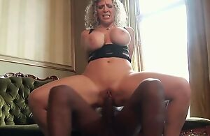 Thick of age with huge melons enjoys railing chunky black cock